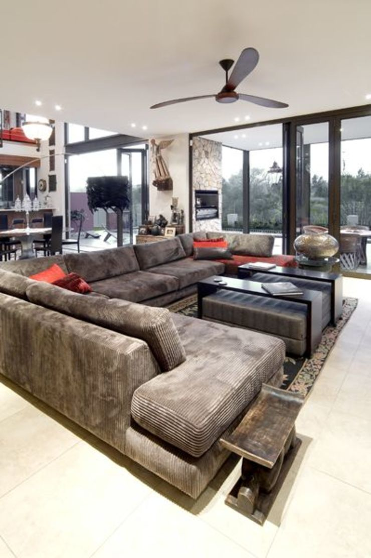 AT WATER'S EDGE Modern living room by Spiro Couyadis Architects Modern