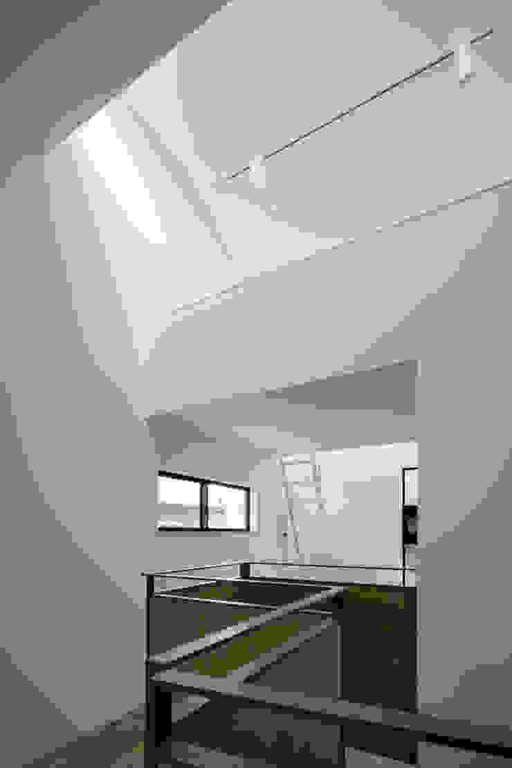 LDK上部のロフト の 株式会社 藤本高志建築設計事務所