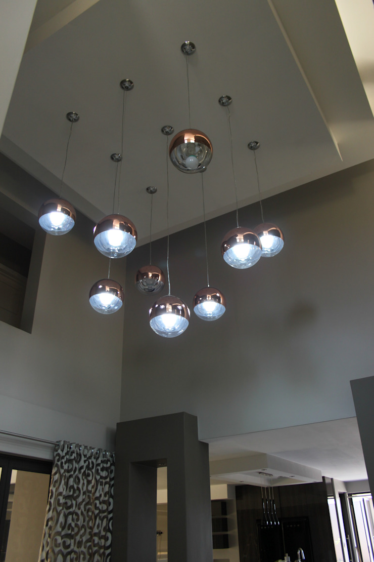 Cluster of pendant lights by Inside Out Interiors Modern
