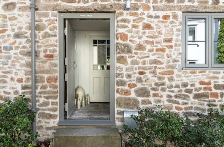 Miner's Cottage II: Front Entrance by design storey Rustic