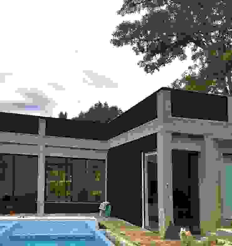 Fase 2 (piscina) Casas modernas de Vertice Oficina de Arquitectura Moderno Concreto