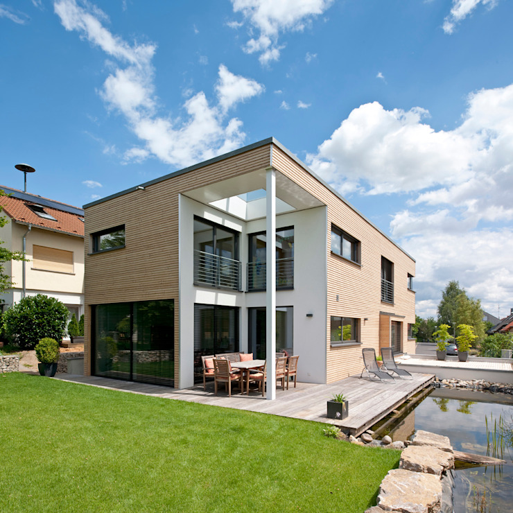 Modern Houses by KitzlingerHaus GmbH & Co. KG Modern Engineered Wood Transparent