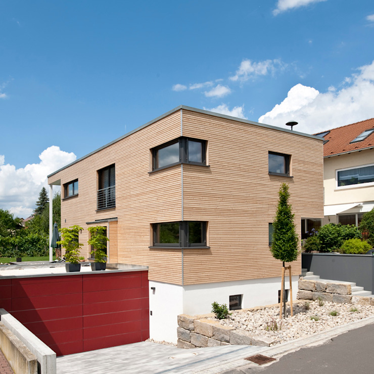 Modern houses by KitzlingerHaus GmbH & Co. KG Modern Engineered Wood Transparent