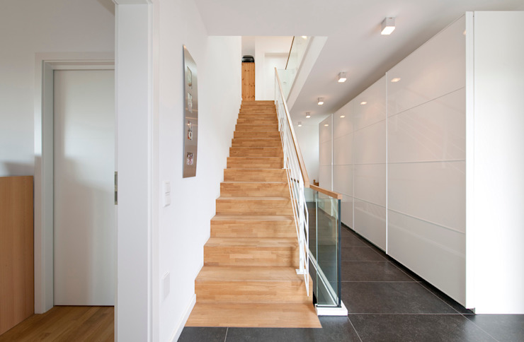 Modern Corridor, Hallway and Staircase by KitzlingerHaus GmbH & Co. KG Modern Wood Wood effect