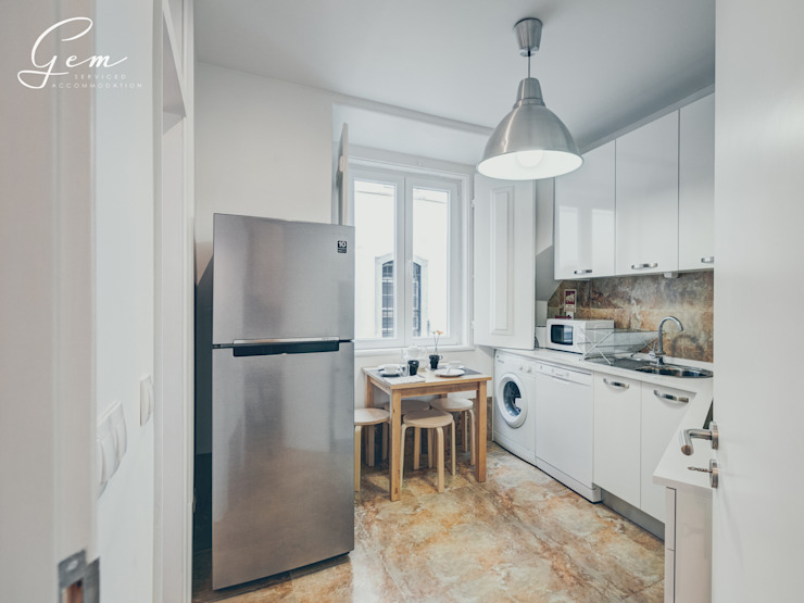 Casa Pombalina: <q>de velho a novo</q>. Cozinhas rústicas por Obrasdecor Rústico Pedra