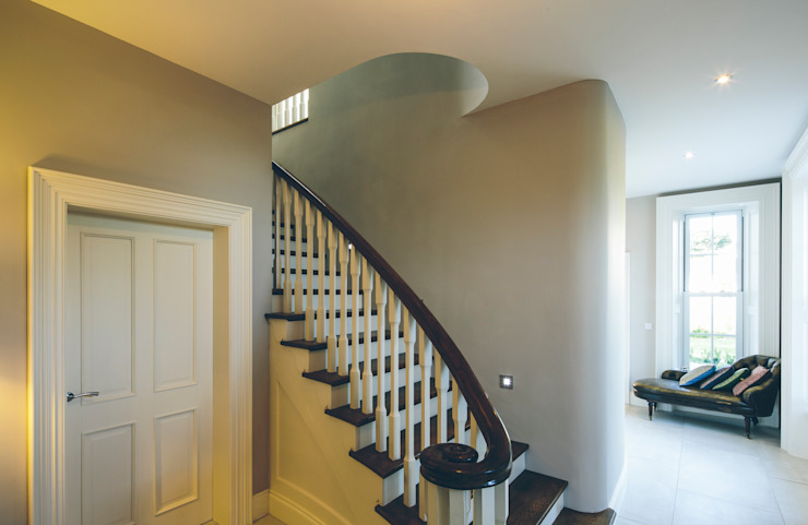 Modest simple classical family home Classic style corridor, hallway and stairs by Des Ewing Residential Architects Classic
