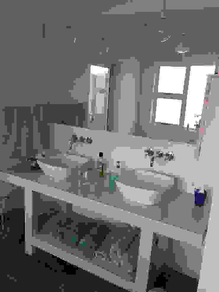 View of new vanity: rustic  by Urban Dwellers Design Studio, Rustic