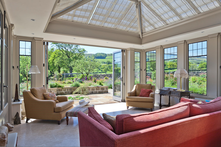 Conservatory with Bronze Casement Windows on a Period Farmhouse Classic style conservatory by Vale Garden Houses Classic Tiles