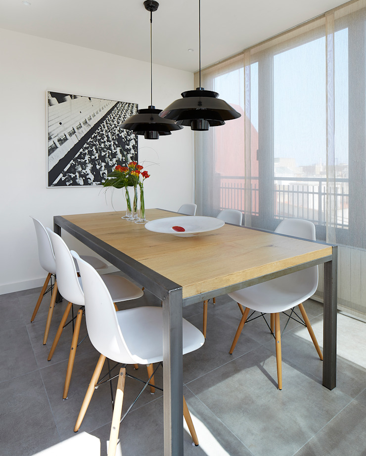 Modern dining room by Molins Design Modern