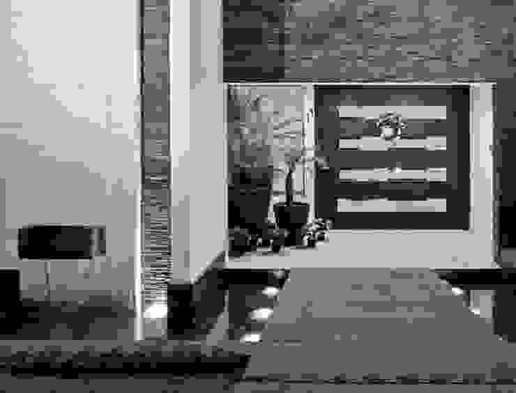 INGRESO PRINCIPAL Casas modernas de Excelencia en Diseño Moderno Piedra