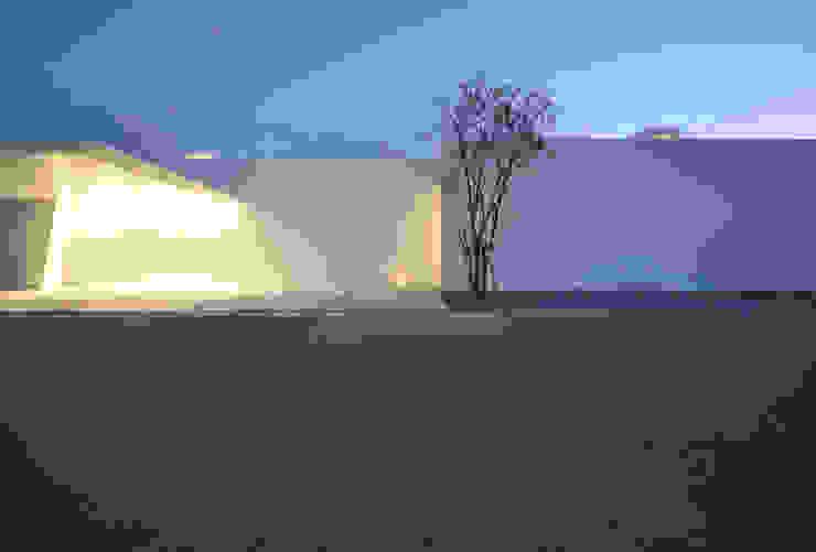 Casas modernas de 門一級建築士事務所 Moderno Concreto reforzado