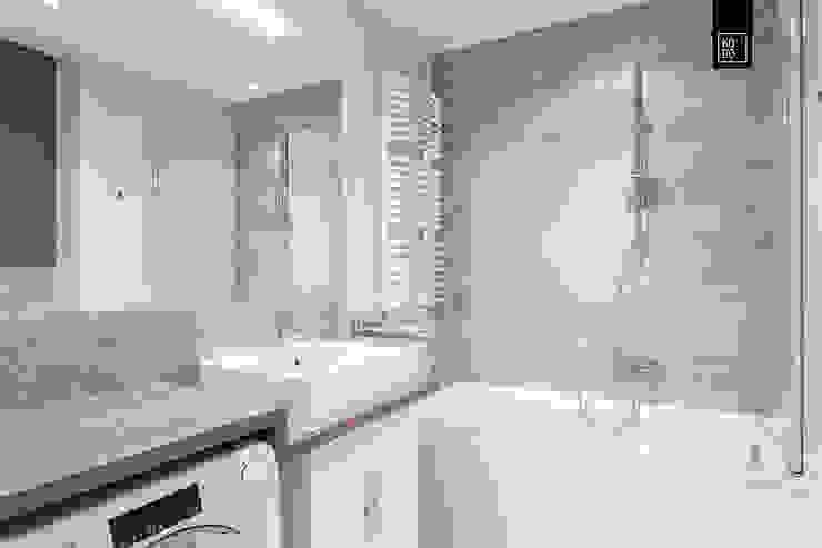 現代浴室設計點子、靈感&圖片 根據 KODO projekty i realizacje wnętrz 現代風