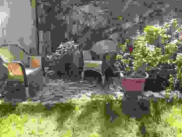 Jardines de estilo ecléctico de homify Ecléctico Piedra