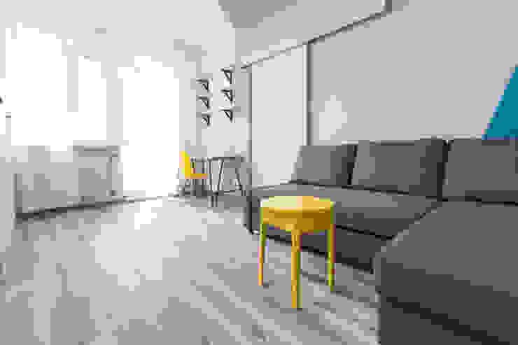 غرفة المعيشة تنفيذ Kraupe Studio, حداثي