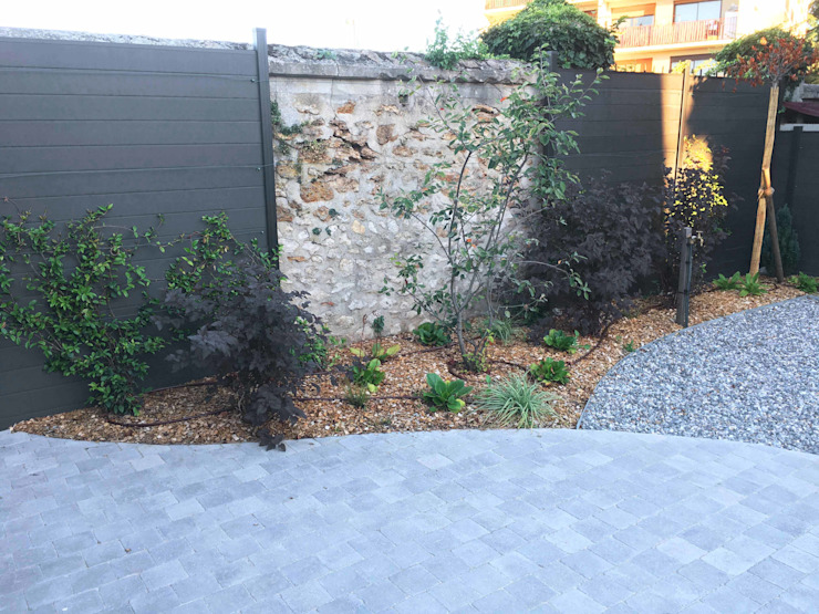 Jardines modernos de homify Moderno Piedra