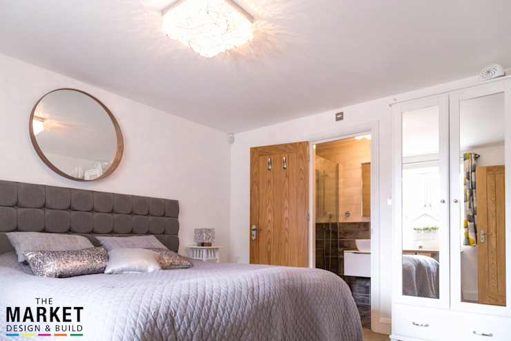 Guests will be more than happy in here... Modern style bedroom by The Market Design & Build Modern