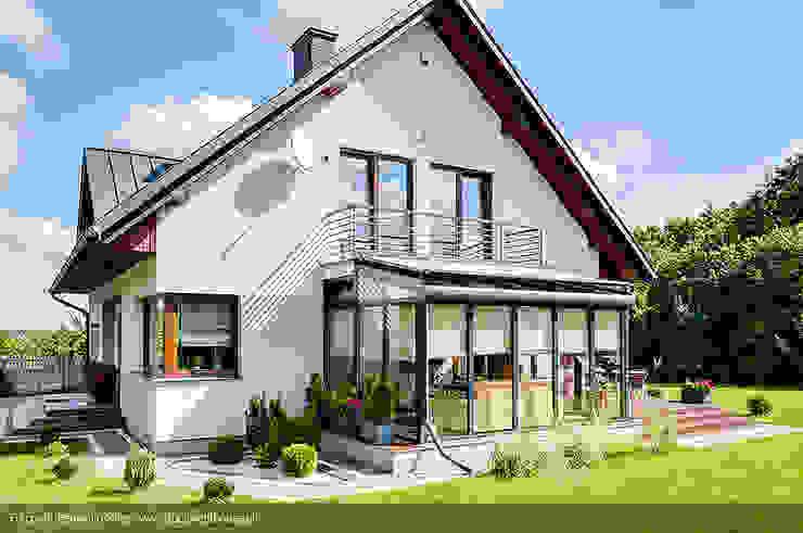 Casas modernas por Biuro Projektów MTM Styl - domywstylu.pl Moderno