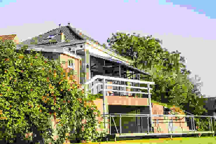 Transformatie gemaal delft Industriële balkons, veranda's en terrassen van Woon Architecten Industrieel