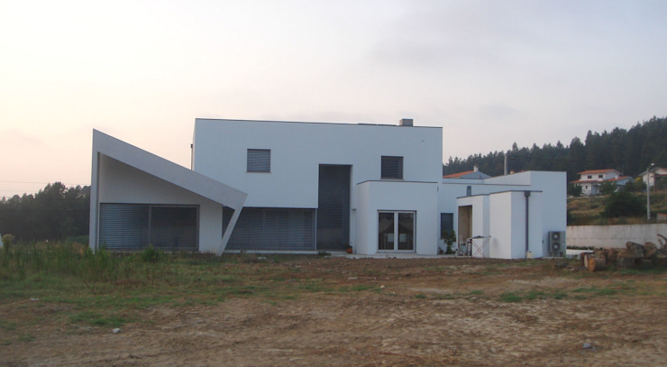 Arquitecto Aguiar Casas de estilo minimalista Concreto reforzado Blanco