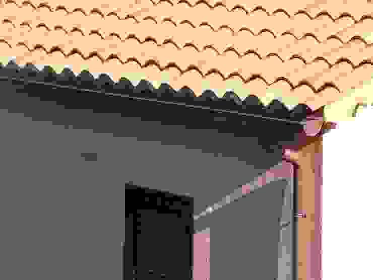 Complesso residenziale 2 FERRARO GRONDE di Ferraro Carlo Case in stile mediterraneo Rame / Bronzo / Ottone Arancio