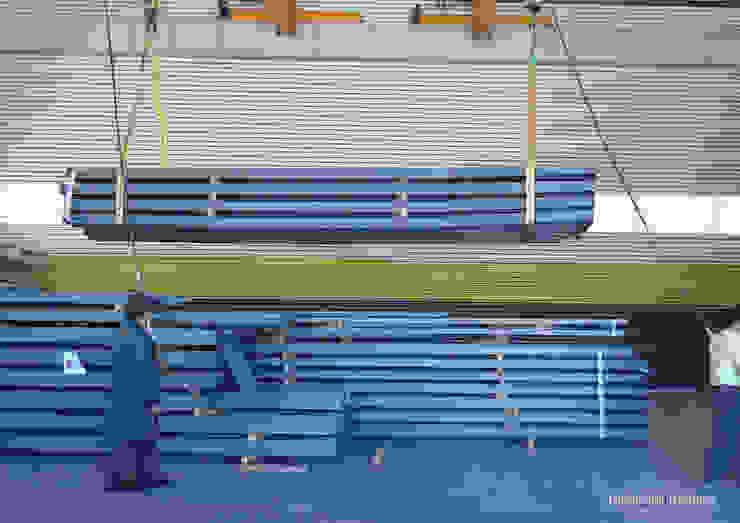 Bahia Comercial - carregamento de estrutura metálica — em Leiria. por Esfera de Imagens Lda