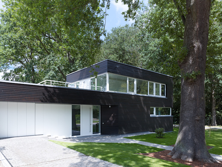Дома в стиле модерн от Justus Mayser Architekt Модерн Дерево Эффект древесины