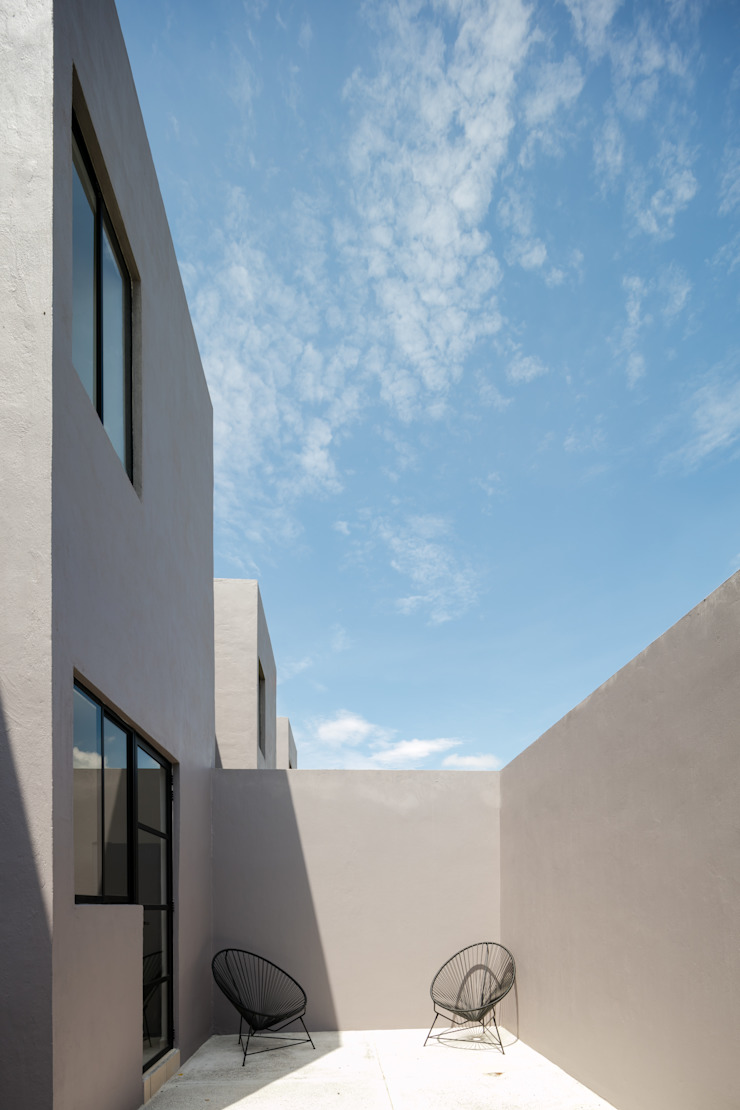 Viviendas San Ignacio Balcones y terrazas modernos de IX2 arquitectura Moderno