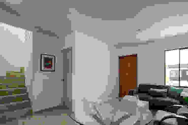Viviendas San Ignacio Salones modernos de IX2 arquitectura Moderno