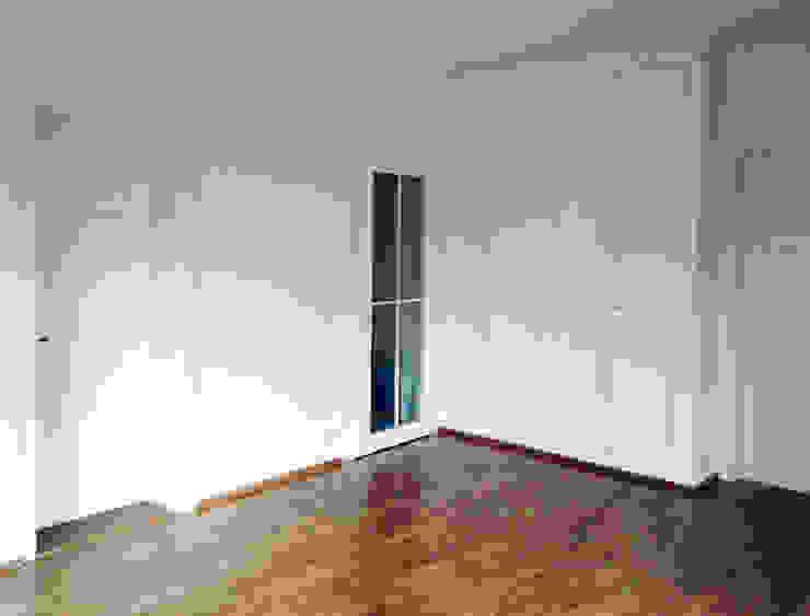 Sala multimediale in stile classico di mmarch gmbh - Mader Marti Architektur ETH SIA Classico Legno Effetto legno