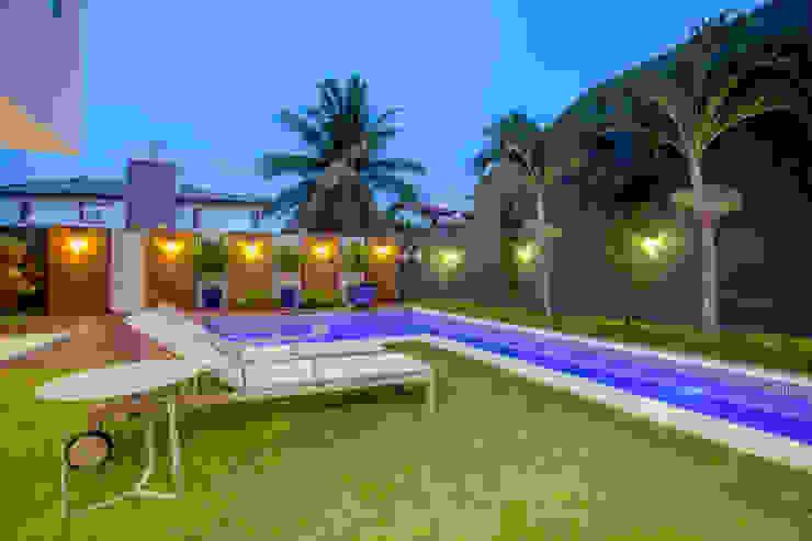 Jardines de estilo moderno de Eveline Sampaio Arquiteta e Designer de Interiores Moderno Piedra
