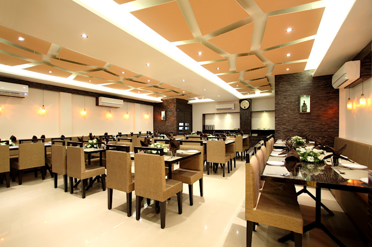 Restaurant Dining Area by SS Designs Modern