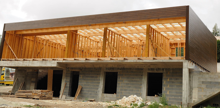 Casas modernas: Ideas, imágenes y decoración de Lethes House Moderno Madera Acabado en madera
