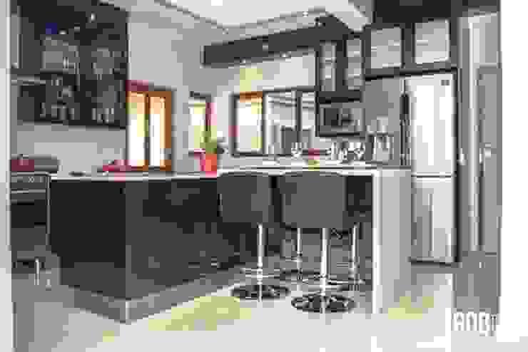 Dark Mahogany Kitchen Modern kitchen by Ergo Designer Kitchens Modern Wood Wood effect