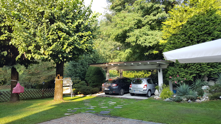 Rustic style garage/shed by MARA GAGLIARDI 'INTERIOR DESIGNER' Rustic