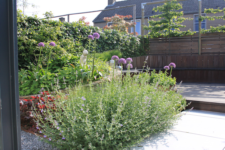 Achtertuin Maastricht Moderne tuinen van Hoveniersbedrijf Guy Wolfs Modern Leisteen