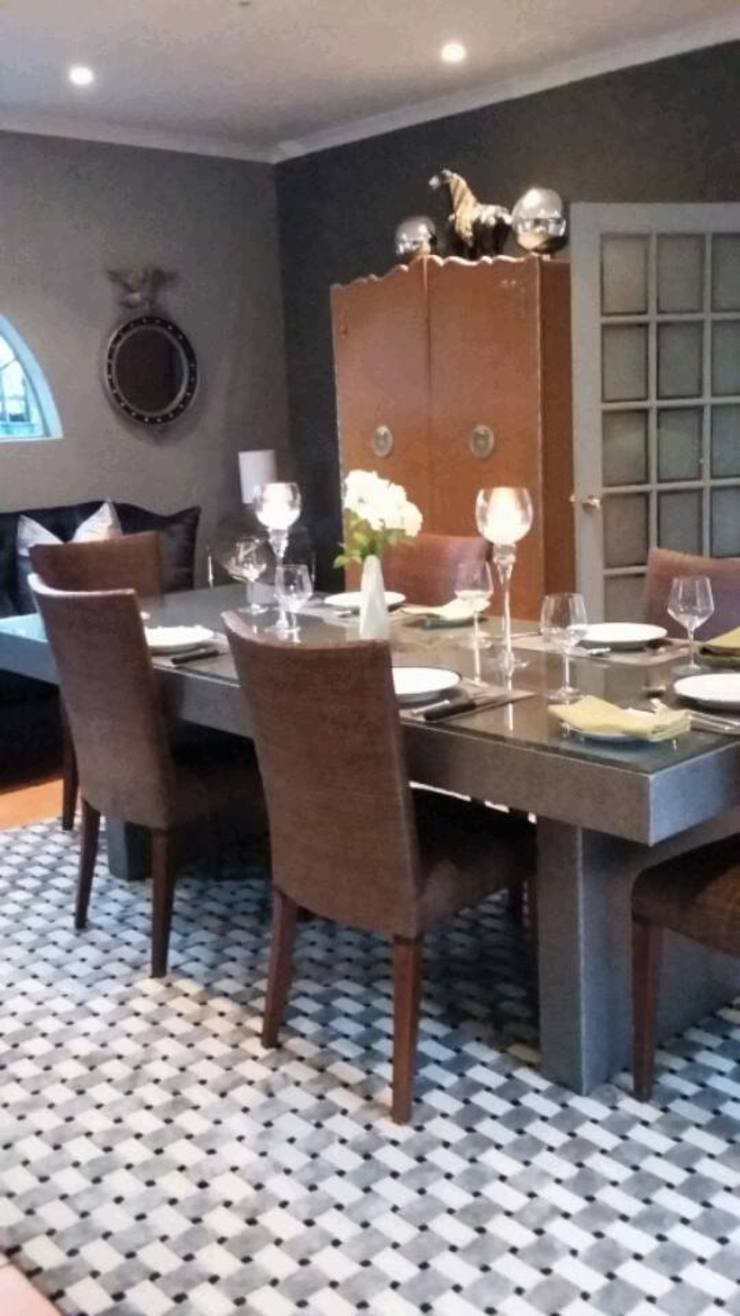 Grey House Eclectic style dining room by CKW Lifestyle Associates PTY Ltd Eclectic