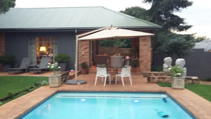 Grey House CKW Lifestyle Associates PTY Ltd Eclectic style pool
