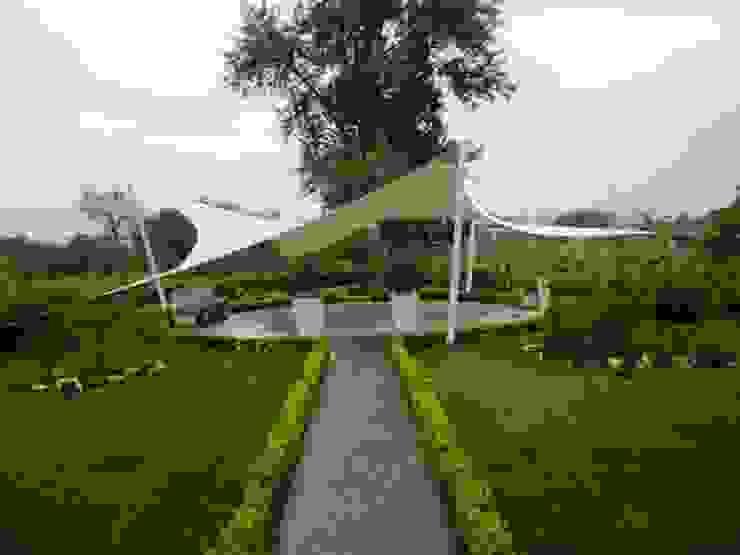 Mediterranean style garden by Fervistudio Outdoor Mediterranean Wood-Plastic Composite