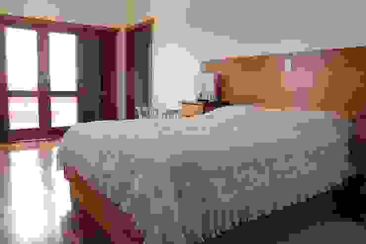 Camera da letto in stile rustico di Lozí - Projeto e Obra Rustico