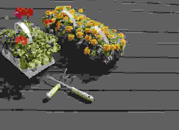 NovaDeck es antideslizante. Especial para pisos exteriores y áreas húmedas. Jardines modernos de FORMICA Venezuela Moderno Madera Acabado en madera