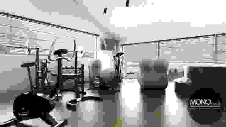 Pokój do ćwiczeń Minimalistyczna siłownia od MONOstudio Minimalistyczny