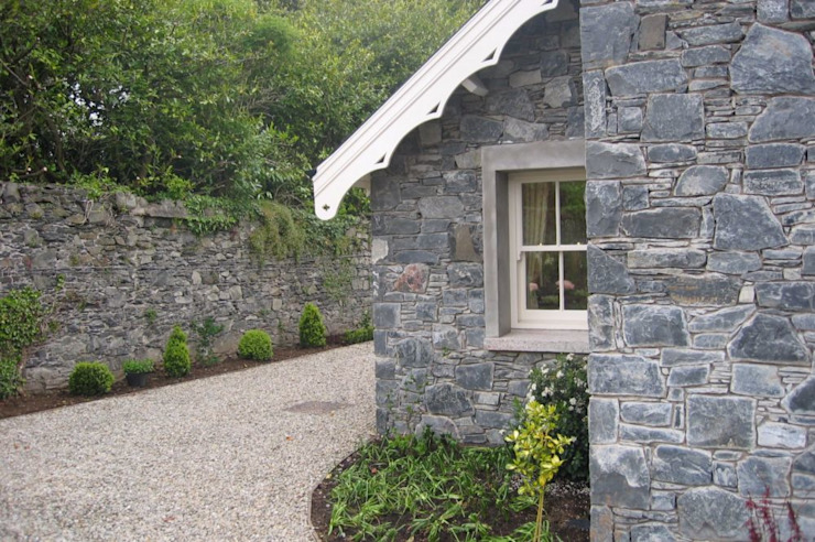 New Stone Built Cottage Set in Walled Garden in Conservation Area Rustic style house by Des Ewing Residential Architects Rustic