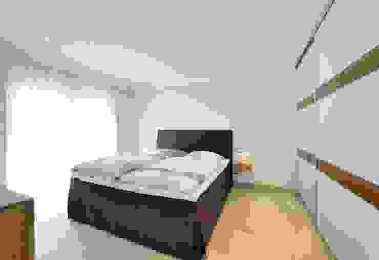 Спальня в стиле модерн от Heinz von Heiden GmbH Massivhäuser Модерн