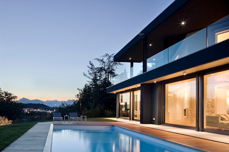Casas modernas por iarchitects Moderno