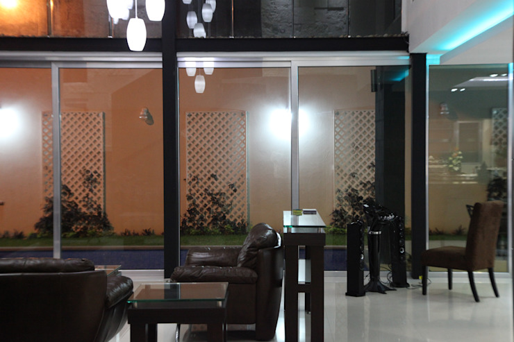 CASA BALLENA Salones minimalistas de DISEÑO APLICADO AVANZADO DE GUADALAJARA 2 Minimalista Aluminio/Cinc