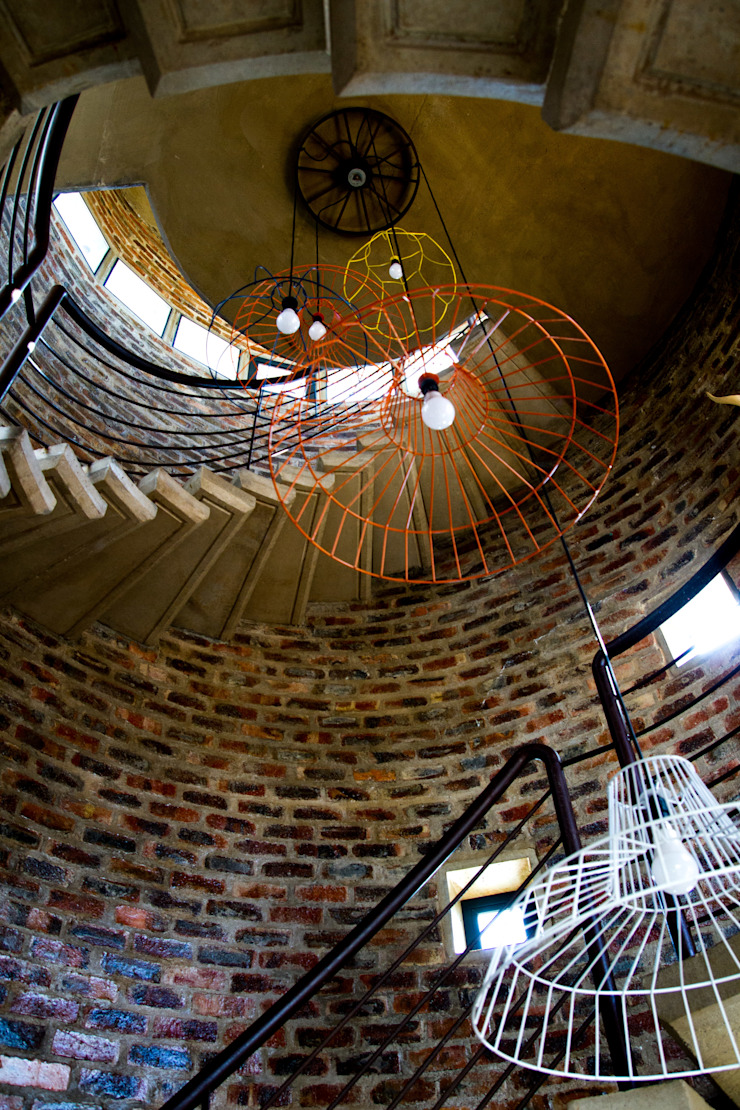 Barn House - Silo spiral staircase Country style corridor, hallway& stairs by Strey Architects Country Bricks
