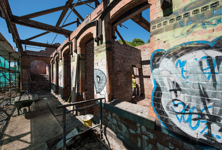 Renovation and conservation of derelict train station into five bespoke properties by Des Ewing Residential Architects Рустiк