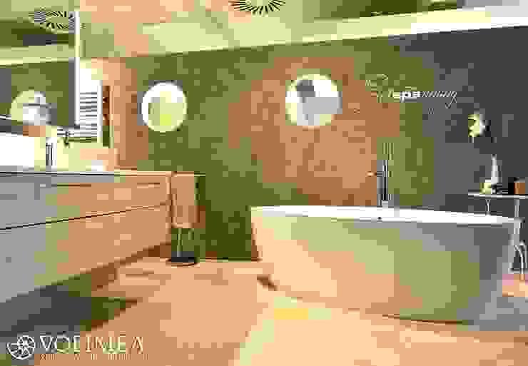 Solitär stehende Badewanne vor fugenloser Wand Volimea GmbH & Cie KG Moderne Badezimmer Marmor Braun