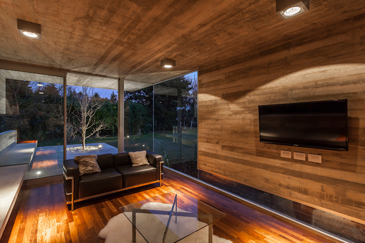 Pabellón Casa Torcuato Paredes y pisos modernos de Besonías Almeida arquitectos Moderno Concreto