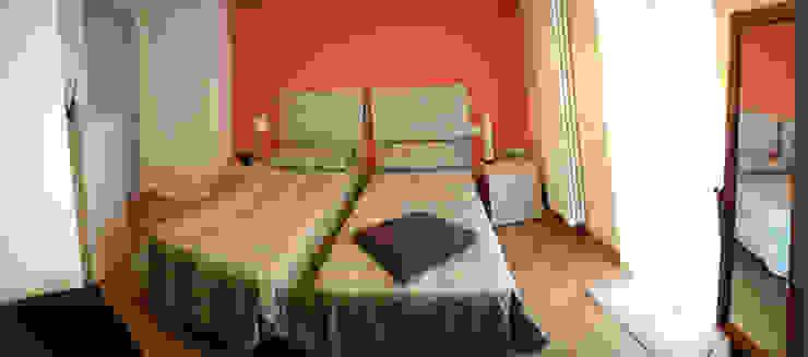Fabio Ricchezza architetto Modern style bedroom Orange